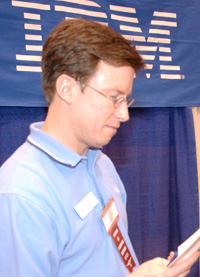IBM recruiter studies a student's resume