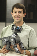 Dr. Peter H. Stone with a Sony Aibo soccer-playing robot