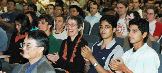 Audience reacting to Professor Cline's speech, Professor Lam, front left